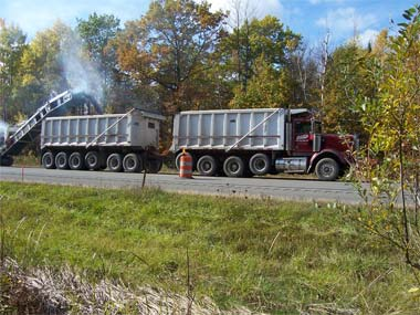 A Cold Milling Machine removes old asphalt from the road